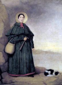 Mary Anning med geologhammare och spanieln Tray, målad före 1842. I bakgrunden klippan Golden Cap i Dorset